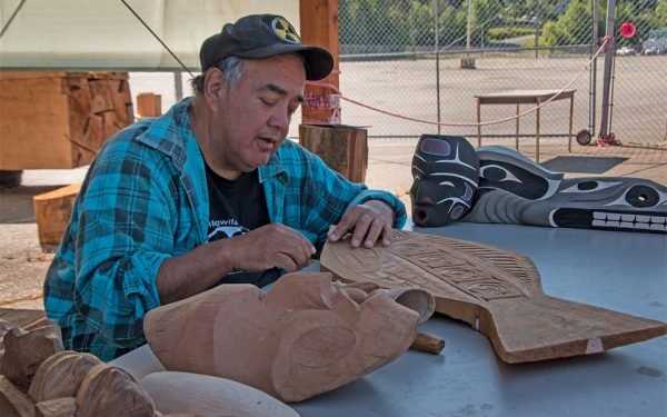 Indigenous Artist carving wood